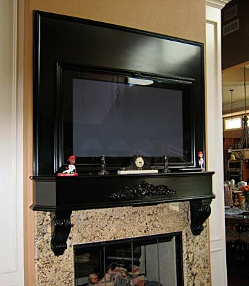 fireplace mantel and TV