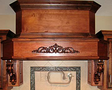 Carved kitchen range hood
